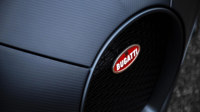 Bugatti's hand-crafted Macaron badge contains silver and takes 10 hours to create